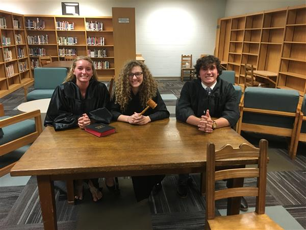From left to right: Delaney Morris (Bailiff), Alyssa Bump (Lead Judge), Connor Whitney (Judge)